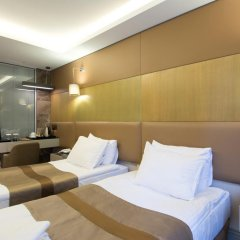 Отель GK Regency Suites 4* Номер Бизнес с различными типами кроватей фото 3