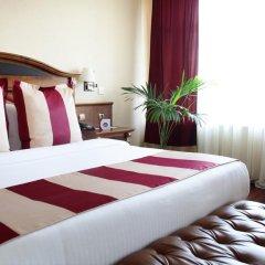Гостиница Crowne Plaza Minsk 5* Улучшенный номер двуспальная кровать фото 9