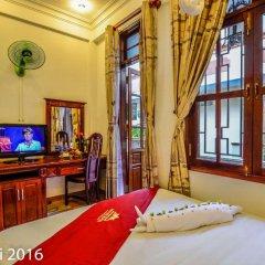 Отель Nhi Nhi 3* Номер Делюкс фото 2