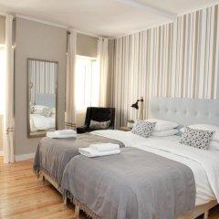 Отель Flores Guest House 4* Улучшенный номер с различными типами кроватей фото 4
