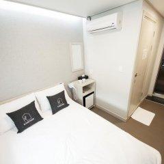 K-Grand Hotel & Guest House Seoul 2* Стандартный номер с двуспальной кроватью фото 2