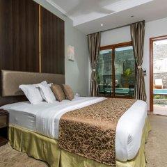 Отель Kaani Village & Spa 4* Номер Делюкс с различными типами кроватей фото 5