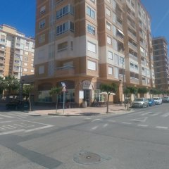 Отель Apartamentos Milenio парковка