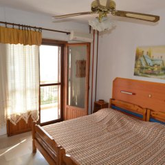 Отель Studios Oasis комната для гостей фото 5