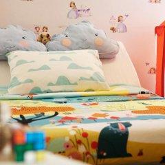 Village Hotel Bugis 4* Улучшенный семейный номер с двуспальной кроватью фото 2