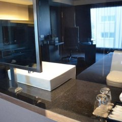 Отель Golden Tulip Mandison Suites 4* Номер Делюкс фото 6