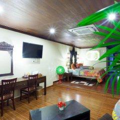 Отель Tropica Bungalow Resort 3* Семейный номер Делюкс с двуспальной кроватью фото 6