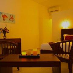 Whispering Palms Hotel 3* Номер Делюкс фото 6