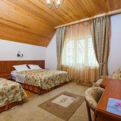 Гостиница Каприз Стандартный семейный номер с разными типами кроватей фото 3