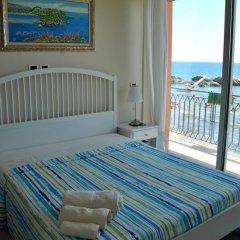 Отель Taorminaxos wonderful seaview Таормина комната для гостей фото 5