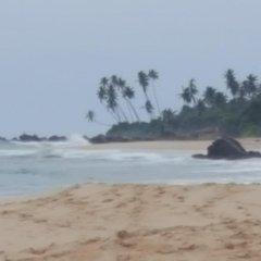 Отель Serene Holiday Bungalow пляж