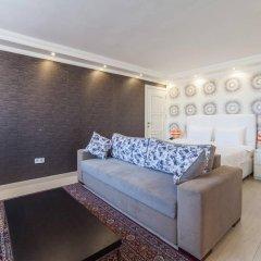 Отель Defne Suites Номер Делюкс с различными типами кроватей фото 10