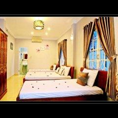 Отель Green Garden Homestay 2* Стандартный семейный номер с двуспальной кроватью фото 7
