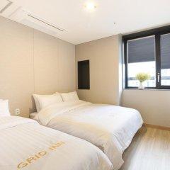 Отель Grid Inn 2* Студия с различными типами кроватей фото 5