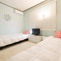 Kpopstarz Guesthouse - Caters to Women (отель для женщин) 2* Номер с общей ванной комнатой с различными типами кроватей (общая ванная комната) фото 8