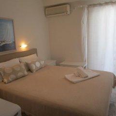 Hotel Milos комната для гостей