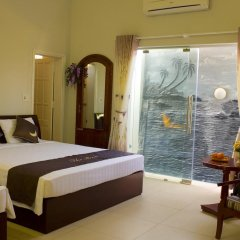 Отель The Moon Villa Hoi An 2* Стандартный семейный номер с различными типами кроватей фото 27