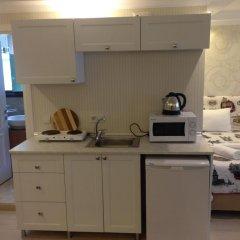 Отель Defne Suites Улучшенные апартаменты с различными типами кроватей фото 3