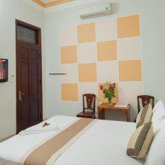 Отель Tra Que Flower Homestay Стандартный номер с двуспальной кроватью фото 8