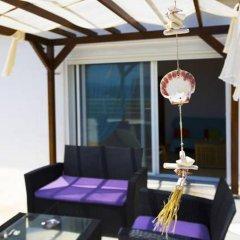 Отель Salonikiou Beach Deluxe Apartments Греция, Аристотелес - отзывы, цены и фото номеров - забронировать отель Salonikiou Beach Deluxe Apartments онлайн интерьер отеля