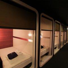 Отель First Cabin Tsukiji Капсула в мужском общем номере фото 2