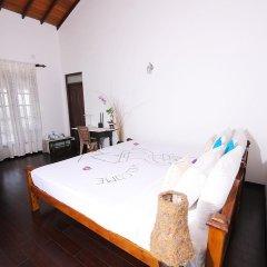 Отель Lahiru Villa 2* Номер Делюкс с различными типами кроватей фото 3