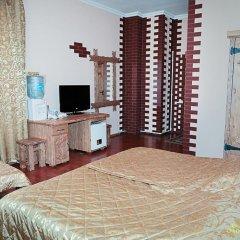Гостиница Охотничья Усадьба Стандартный семейный номер с разными типами кроватей фото 12