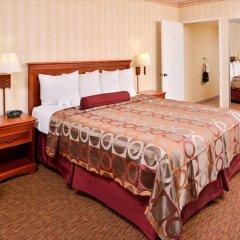 Отель Best Western Plus Raffles Inn & Suites сейф в номере