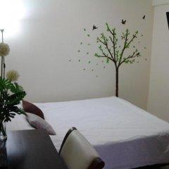 Отель AT. Center Guesthouse and Motorbike Pattaya комната для гостей