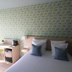 Отель Hôtel Du Centre 2* Улучшенный номер с различными типами кроватей фото 2