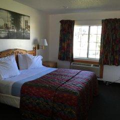 Отель 99 Palms Inn & Suites 2* Стандартный номер с двуспальной кроватью фото 2