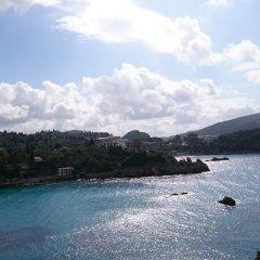 Отель Phivos Studios Греция, Палеокастрица - отзывы, цены и фото номеров - забронировать отель Phivos Studios онлайн пляж