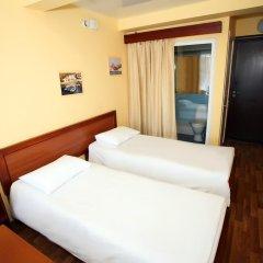 Гостиница Дискавери Стандартный номер с 2 отдельными кроватями фото 3