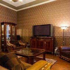 Отель Comfy Riga - Apartment St. Peter's Church Латвия, Рига - отзывы, цены и фото номеров - забронировать отель Comfy Riga - Apartment St. Peter's Church онлайн интерьер отеля