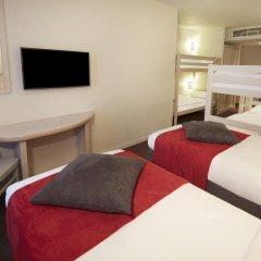 Отель Campanile Val de France 3* Стандартный номер с двухъярусной кроватью фото 8