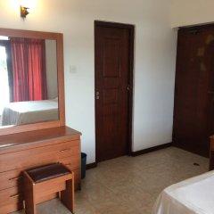 Отель Riverside Inn Fuji Шри-Ланка, Бентота - отзывы, цены и фото номеров - забронировать отель Riverside Inn Fuji онлайн удобства в номере фото 2