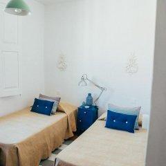 Отель Dona Fina Guest House Стандартный номер 2 отдельные кровати фото 2