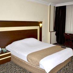 Hotel Tilmen комната для гостей