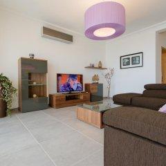 Отель Seafront Apartment Sliema Мальта, Слима - отзывы, цены и фото номеров - забронировать отель Seafront Apartment Sliema онлайн комната для гостей фото 5