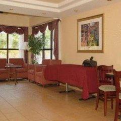 Отель All Seasons Inn and Suites интерьер отеля