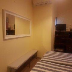 Отель Residencial Caldeira сейф в номере