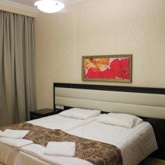 Апартаменты Времена Года Красная поляна комната для гостей фото 3