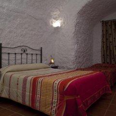 Отель Cuevas Blancas комната для гостей