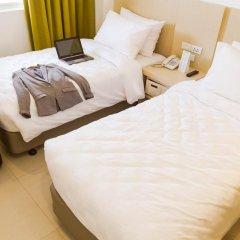 Отель Go Hotels Manila Airport Road 3* Стандартный номер с 2 отдельными кроватями фото 2