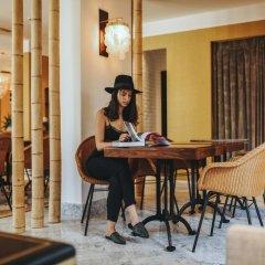 Melody Hotel - an Atlas Boutique Hotel Израиль, Тель-Авив - отзывы, цены и фото номеров - забронировать отель Melody Hotel - an Atlas Boutique Hotel онлайн интерьер отеля