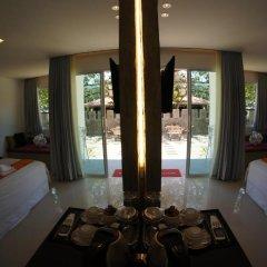 Отель TT Naiyang Beach Phuket 2* Улучшенный номер разные типы кроватей фото 9