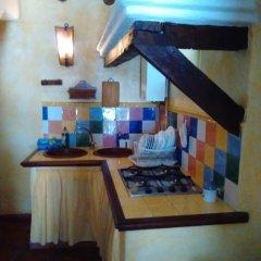 Отель El Rinconcito в номере фото 2