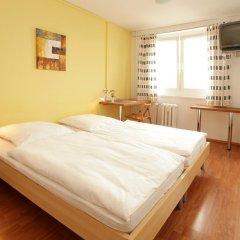 Отель a&o Dresden Hauptbahnhof 2* Стандартный номер с 2 отдельными кроватями фото 5