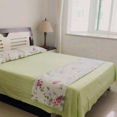Отель Golden Mango Апартаменты с 2 отдельными кроватями фото 12