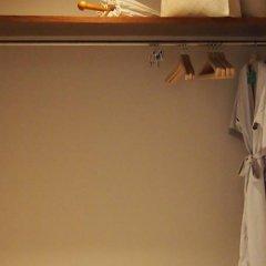 Sankara Hotel & Spa Yakushima Якусима сейф в номере